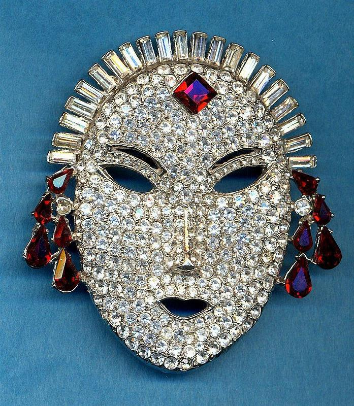 BUTLER AND WILSON MASK BROOCH