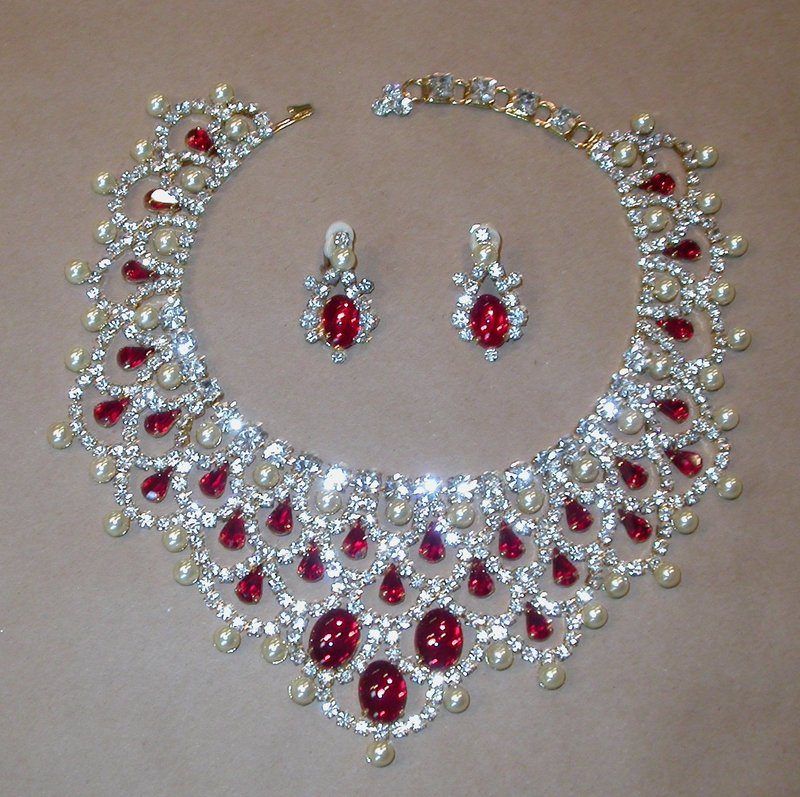 LAWRENCE VRBA DRAMATIC BIB NECKLACE AND CLIP EARRINGS