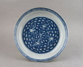 A Rare Ming Dynasty White On Blue Dish