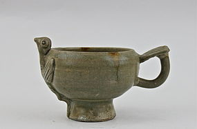 FIVE DYNASTY YUEYAO CELADON BOWL WITH RELIEF OF A BIRD