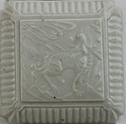 A MING DYNASTY WHITE GLAZE SQUARE SHAPED COVERED BOX WITH QIRIN