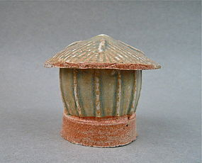 A SONG DYNASTY FUJIAN QINGBAI OF GRANARY WITH COVER OF ROOF TILE