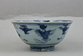 A MING 15TH CENTURY B/W BOWL WITH FOUR PHOENIX AMONG CLOUD SCROLLS