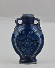 A BLUE GLAZED SNUFF BOTTLE WITH INCISED BUTTERFLY AND CHRYSANTHEMUM
