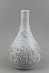 WHITE GLAZED BOTTLE VASE WITH LOW RELIEF OF THREE FRIENDS OF WINTER