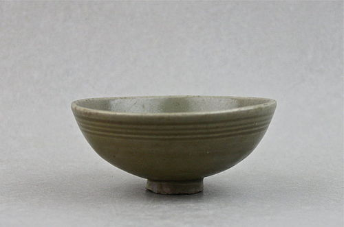 A YUAN DYNASTY CELADON TEA-BOWL