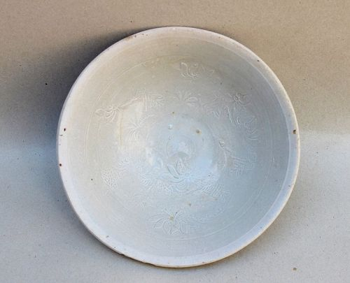 A YUAN DYNASTY FUJIAN PROVINCE WARE MOLDED INCISED BOWL