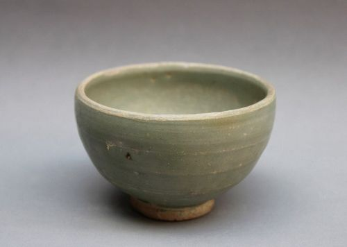 YUAN DYNASTY CELADON CUP WITH STAMP OF FLOWER HEAD