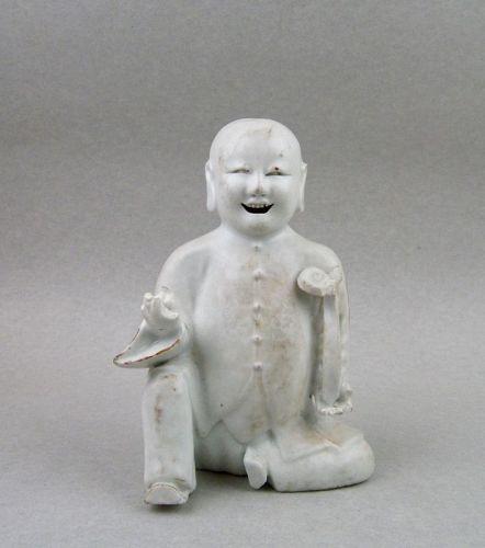 18th CENTURY WHITE GLAZE SMILING BOY FIGURE HOLDING RUYI