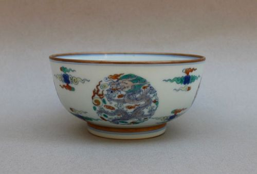 A RARE KANGXI DOUCAI BOWL WITH FOUR DRAGON MEDALLIONS