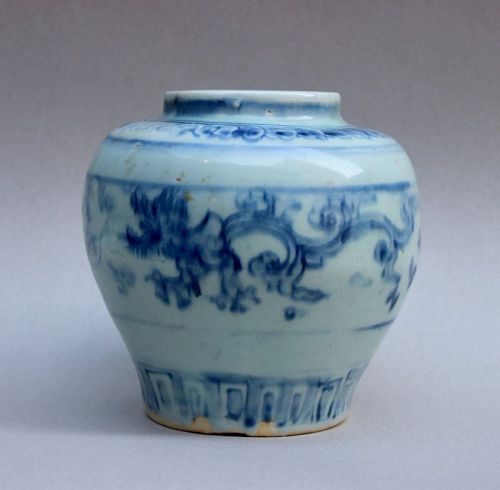 MING DYNASTY BLUE AND WHITE JAR WITH 'GUI' DRAGON HOLDING FLOWER
