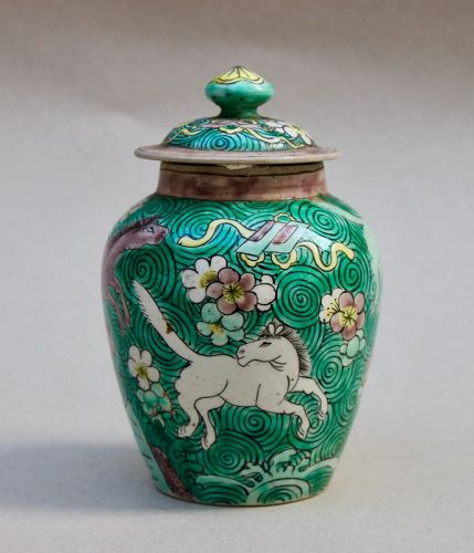 A FINE POLYCHROME JAR & COVER WITH HORSES