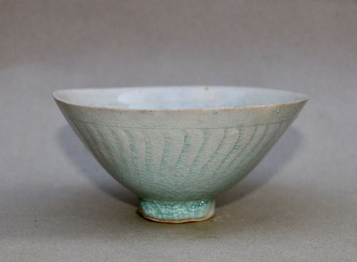 A SONG/YUAN DYNASTY QINGBAI CONICAL BOWL WITH INCISED INFANTS