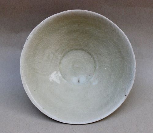 A SONG DYNASTY WITH INCISED FISH CONICAL BOWL