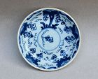 A BLUE AND WHITE QING KANGXI SAUCER DISH