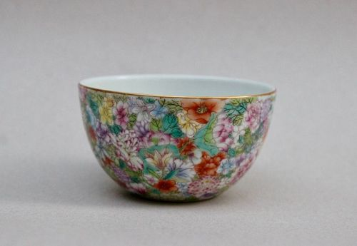 A FINE QING DYNASTY FAMILLE ROSE MILLE FLEURS ROUNDED SIDE CUP