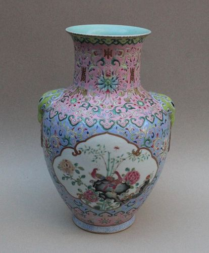 A FINE QING DYNASTY FAMILLE ROSE VASE WITH ELEPHANT MASK
