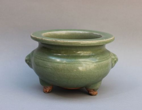 A MING DYNASTY LONGQUAN CELADON TRIPOD CENSER WITH LION MASK