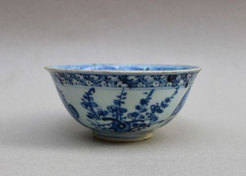 A BLUE AND WHITE BOWL WITH THREE FRIENDS OF WINTER