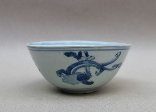 A LATE MING BLUE AND WHITE BOWL WITH SEA-DRAGON