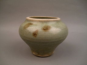 A Yuan Celadon Jarlet With Brown Spots