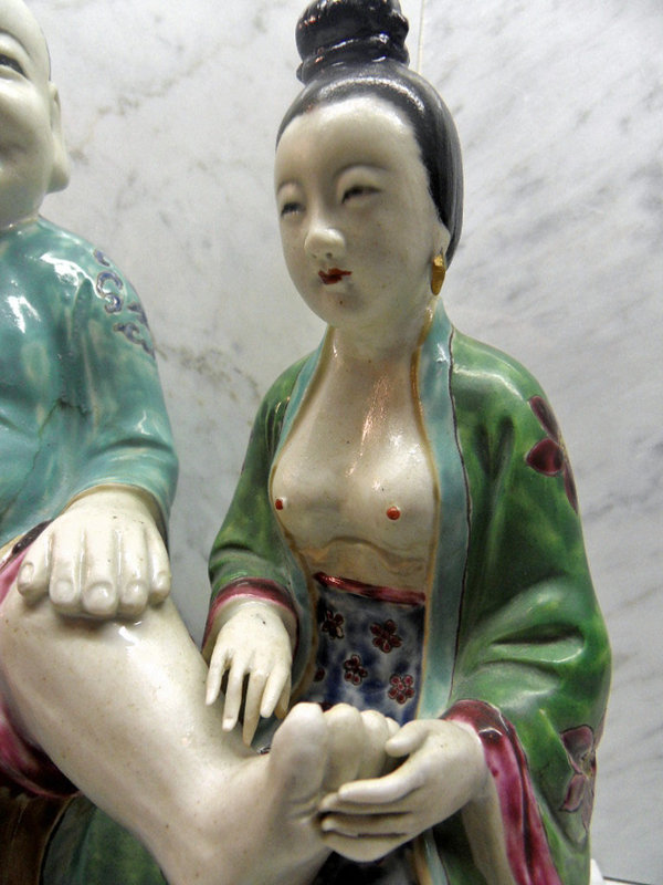 Chinese porcelain statue: Looking after granny