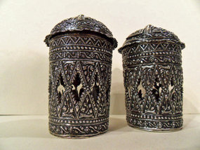 Ceremonial Indonesian silver containers with a glass