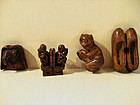 Four antique Chinese wood toggles