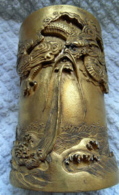 Chinese gold colored porcelain brush pot with dragon