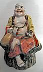 Stoneware Budai or Hotei statue, China