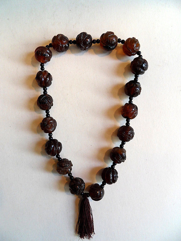 Chinese mala with 18 carved amber prayer beads