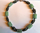 Necklace with carved jade pieces, moss agate and silver