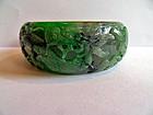 Carved Burmese jade bracelet with dragon, lingzhi, bat