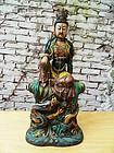 Sancai glazed Guanyin on a dragon throne