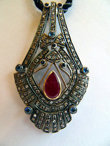 Gold and silver pendant with diamond,ruby,sapphire