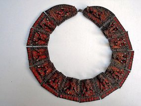 A copper and red coral Buddha statue chain