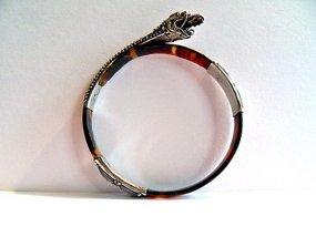 Tortoise shell bracelet with a silver snake