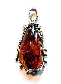 Jugendstil silver mounted amber pendant
