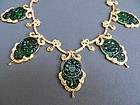 Necklace with five antique jade carvings set in gold