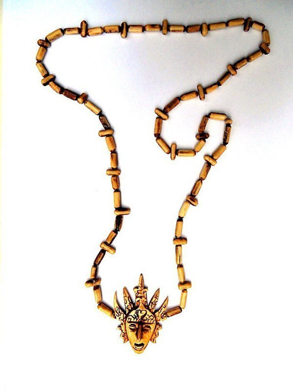 Tribal carved bone necklace from the Moluccas