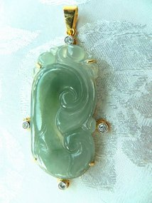Carved natural jadeite pendant with gold and diamonds