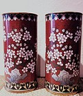 Two brick-red cloisonne brush pots with flowers