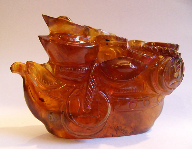 Burmese amber carving of a ship of gold