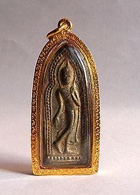 Kamphaengphet Phra Leela Buddha amulet in a gold case