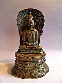 Bronze Buddha in meditation on an engraved lotus throne