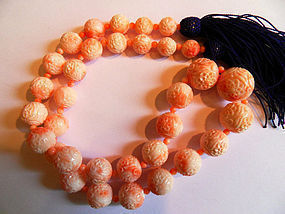String of carved angel skin coral beads