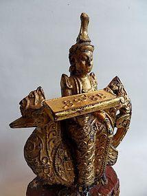 Teak wood carving of a Nat on a hamsa or hintha bird
