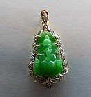 Natural green jadeite Ganesha pendant, mounted in gold with diamonds