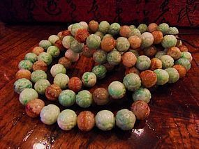 String of 108 carved jadeite beads
