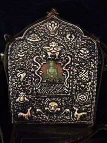 Tibetan gau with the auspicious symbols and the Medicine Buddha